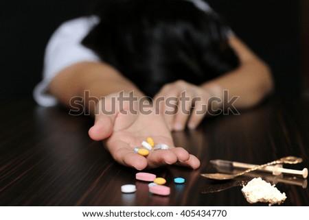 Women Drug addiction overdose on pills and heroin - stock photo