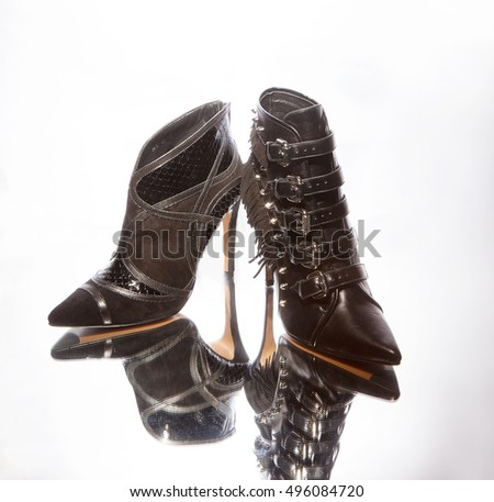 women elegant boots with a reflection