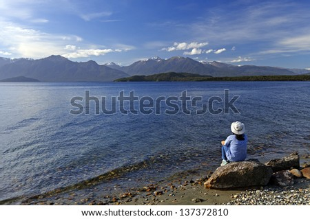 Women enjoying the View of Lake Manapouri in New Zealand - stock photo
