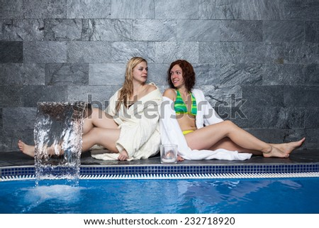 Women enjoying wellness and spa swimming pool. - stock photo