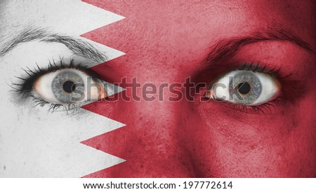 Women eye, close-up, blue eyes, flag of Bahrain - stock photo