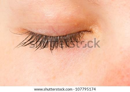 Women eye, close-up, blue, minimum make-up - stock photo
