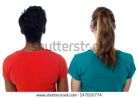 Women facing towards the wall, isolated over white