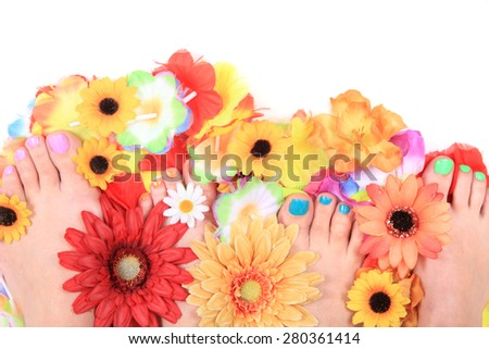 women feets and flowers as nice pedicure background
