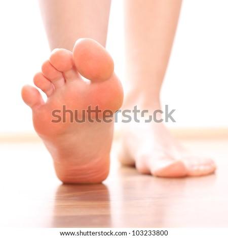 Women Foot stepping - stock photo