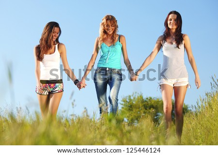 women fun on grass field - stock photo