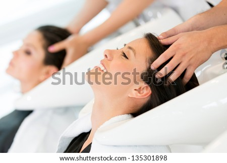 Women getting a hair wash at the beauty salon - stock photo