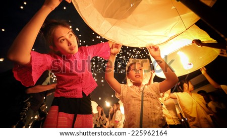 Women girl with thai dress in Loy Kratong Festival - stock photo