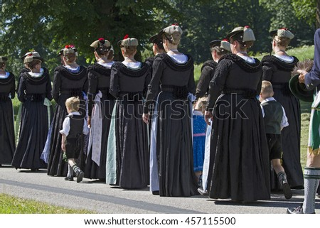 Women go in traditional costume at a procession in Upper Bavaria part - stock photo