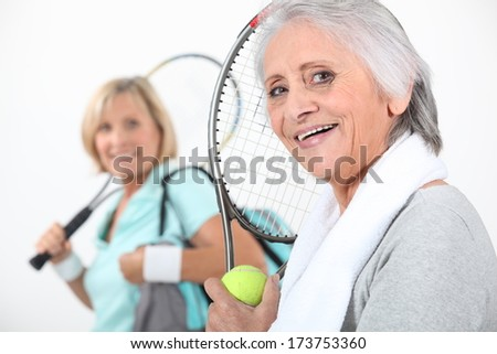 Women going to play tennis - stock photo