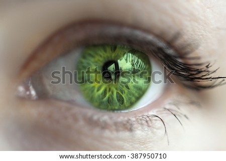 women green  eye color changed with lenses - stock photo