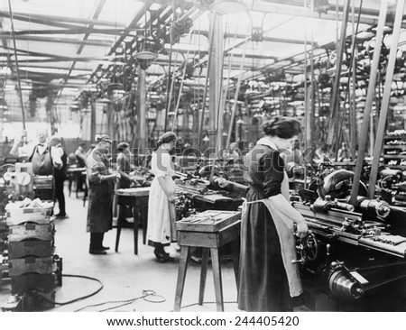 Women grinding barrels of 45 caliber automatics at Colt's Patent Fire Arms Plant, Hartford, Connecticut, between 1914 and 1918. - stock photo