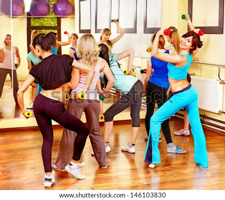 Women group in aerobics class. Back view. - stock photo