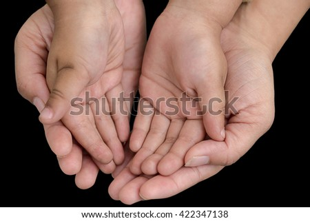 women hand holding baby hand on black isolated background