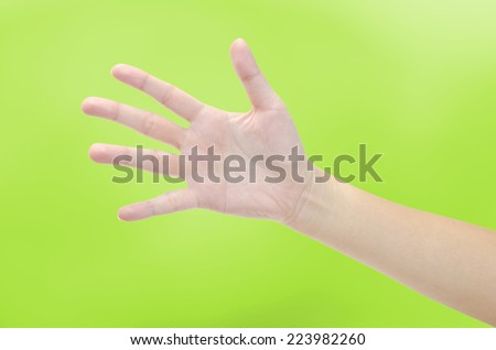 women hand making sign on green background - stock photo