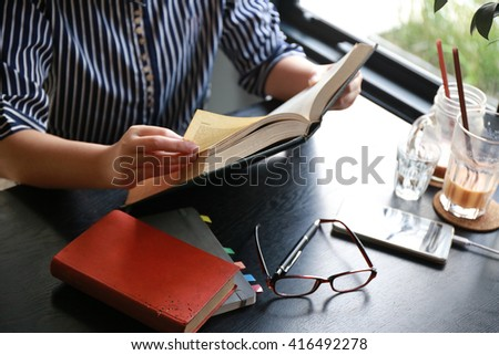 women hand open book for reading,hand writing pen on paper page,hardworking for achievement business target concept, reading book for knowledge concept.  - stock photo
