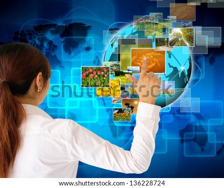 women Hand pushing button streaming multimedia from internet - stock photo