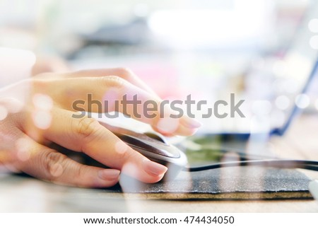 women hand using computer mouse double exposure and blurred view of car on street at night , Computer networking