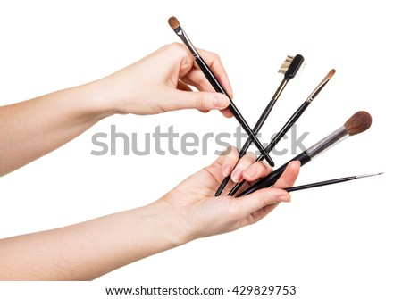 Women hand with cosmetic brushes for makeup isolated on white background.
