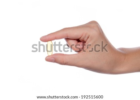 women hand with fish oil capsule isolated on white - stock photo