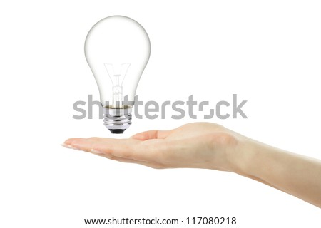 women hand with lamp bulb on white background
