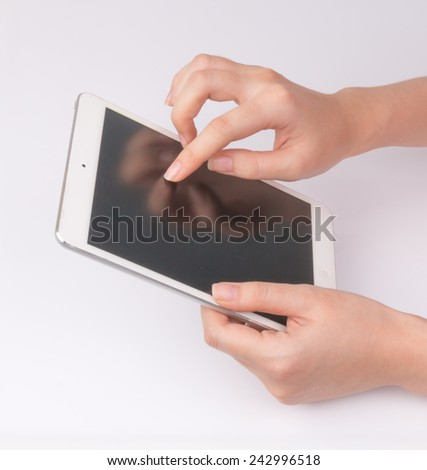 Women hand with tablet isolated on white background