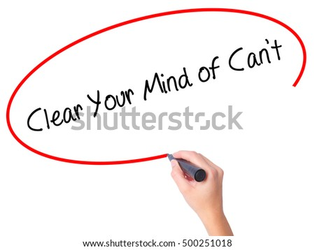 Women Hand writing Clear Your Mind of Can't with black marker on visual screen. Isolated on white. Business, technology, internet concept. Stock Photo