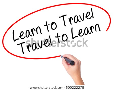 Women Hand writing Learn to Travel. Travel to Learn with black marker on visual screen. Isolated on white. Travel, technology, internet concept. Stock Image