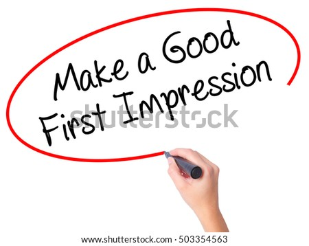 Women Hand writing Make a Good First Impression with black marker on visual screen. Isolated on white. Business, technology, internet concept. Stock Photo