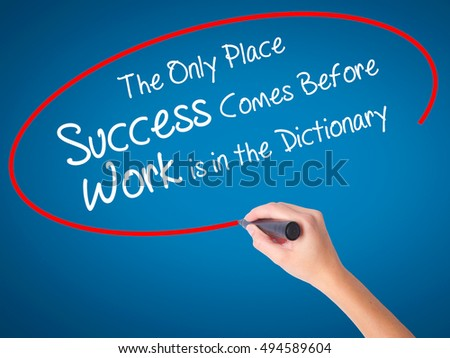 Women Hand writing The Only Place Success Comes Before Work is in the Dictionary with black marker on visual screen. Isolated on blue. Business, technology, internet concept. Stock Photo