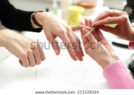 women hands care in beauty salon on white background - stock photo
