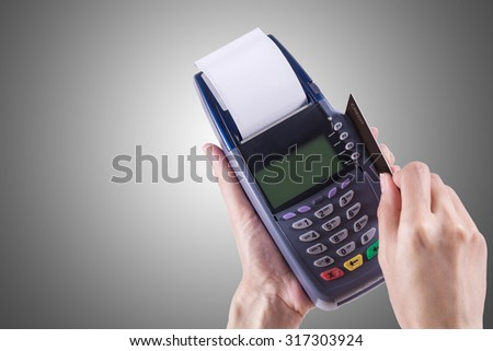 Women Hands swiping Credit card on Credit card machine or Credit card Terminal  - stock photo