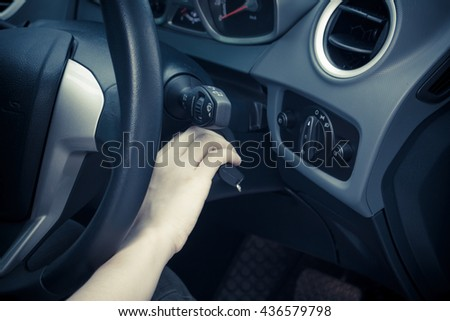 Women hands to take the keys to start the engine car - stock photo