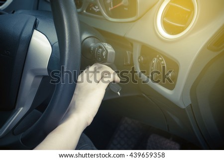 Women hands to take the keys to start the engine car with sunrise - stock photo