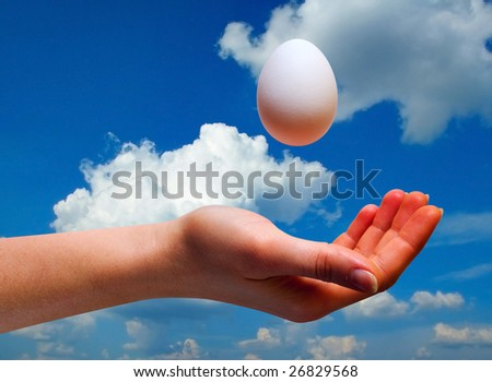 women hands with egg on sky background with clipping path