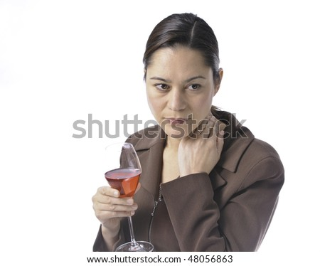 Women having a glass of red wine.She is looking a little sad.White background in studio shot. Women is wearing a wedding ring. - stock photo