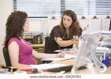 Women having an argument at work - stock photo