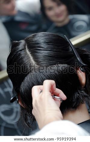 women having her hair cut - stock photo