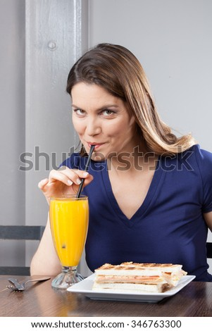 Women having lunch at a bar - stock photo
