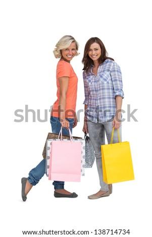 Women holding bags on white background - stock photo