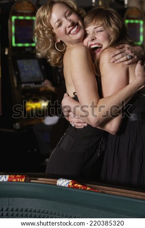Women hugging at a casino - stock photo