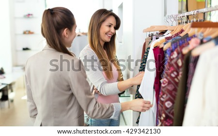 Women in clothes shop - stock photo