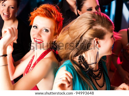Women in club or disco dancing - stock photo