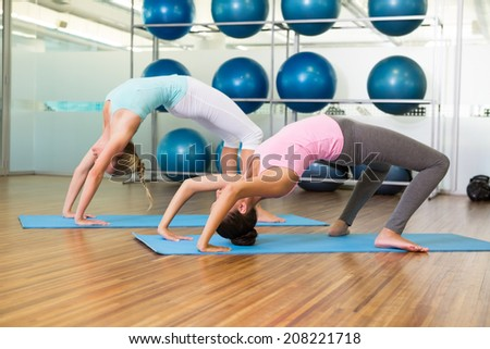 Women in crab pose in fitness studio at the leisure center