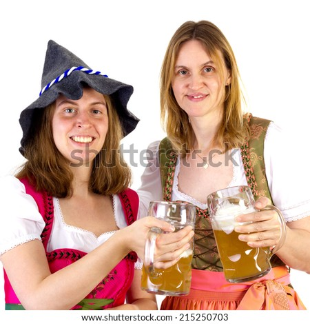 Women in dirndl clinking glasses