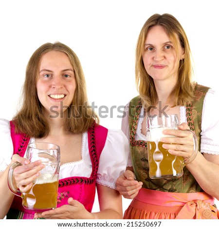 Women in dirndl presenting double beer