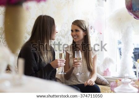 Women in salon happy drinking champagne - stock photo