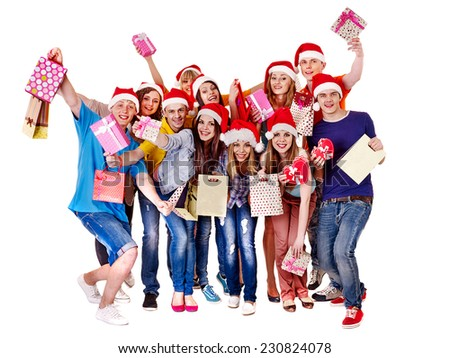 Women in Santa hat holding shopping bag and gift box. - stock photo
