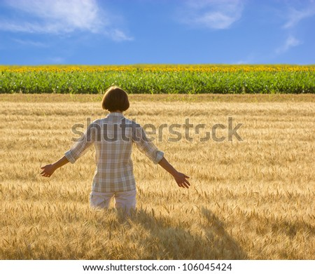 Women in  wheat field at sunset