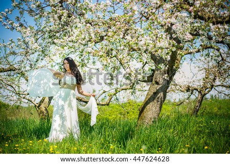 Women in white at the apple orchard